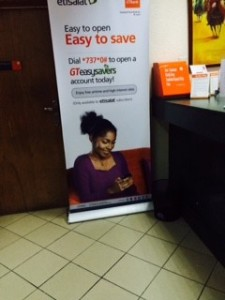 A sign at a nearby GT bank: Set up a savings account via text